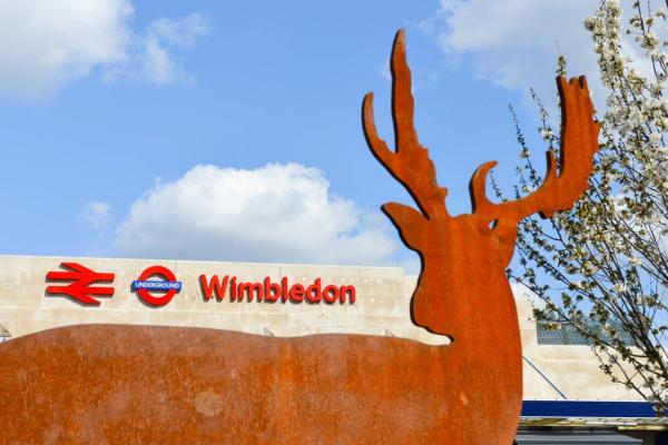 Wimbledon station with stag statue